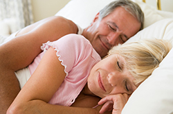 Couple lying in bed sleeping - no snoring